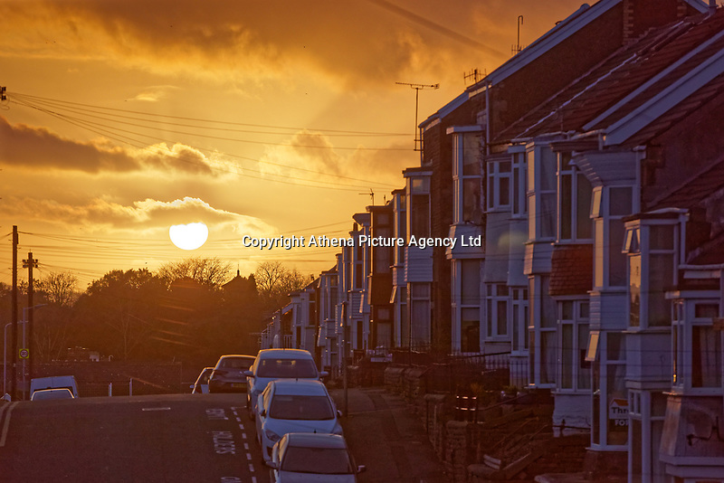 Pictured: The sun sets over terraced houses in Cromwell Street, Swansea, Wales, UK. Monday 18 February 2019