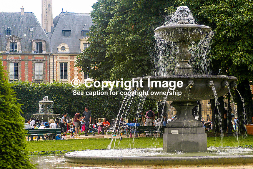 Park in the Place des Vosges, Paris, France. Ref: 200306080187...Copyright Image from Victor Patterson, 54 Dorchester Park, Belfast, UK, BT9 6RJ..Tel: +44 28 9066 1296.Mob: +44 7802 353836.Voicemail +44 20 8816 7153.Skype: victorpattersonbelfast.Email: victorpatterson@mac.com.Email: victorpatterson@ireland.com (back-up)..IMPORTANT: If you wish to use this image or any other of my images please go to www.victorpatterson.com and click on the Terms & Conditions. Then contact me by email or phone with the reference number(s) of the image(s) concerned.