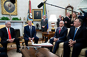United States President Donald J. Trump (C) delivers remarks to members of the news media beside Prime Minister Benjamin Netanyahu of Israel (L) during their meeting in Oval Office of the White House, as US Vice President Mike Pence (2-R) and US Secretary of State Mike Pompeo (R) look on, in Washington, DC, USA, 27 January 2020. President Trump is expected to unveil a Middle East peace plan during the visit of Prime Minister Netanyahu, 28 January.<br /> Credit: Michael Reynolds / Pool via CNP