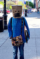 NEW YORK, NY - MAY 21: Woman spotted wearing a paper bag with a drawn-on mask while walking in Greenwich Village during the coronavirus pandemic in New York City on May 21, 2020. Credit: Rainmaker Photos/MediaPunch
