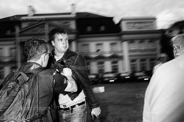 Warsaw, Old City 10.07.2017 Poland<br /> In the picture Michal Rachon journalist of the Polish National Television and sympathizer of the PiS party tries to provoke a crowd of counter-manifestants. Around 2,000 people on Monday took part in an anti-government street protest in Warsaw. The demonstration was held in opposition to a monthly march carried out by governing Law and Justice (PiS) party leader Jaroslaw Kaczynski in memory of his twin brother Lech, Poland's president at the time, and 95 other people who were killed when the presidential jet crashed in Russia in 2010.<br /> Photo: Adam Lach / Napo Images <br /> <br /> Kontrmiesiecznica zorganizowana przez KOD, Obywateli RP i inne sily opozycyjne, z okazji 83 miesiecznicy Smolenskiej. N/Z Michal Rachon dziennikarz TVP i sympatyk partii PiS prowokuje tlum kontrmanifestantow, ochroniarze obywateli RP staraja sie go wypchnac z manifestacji.<br /> Fot: Adam Lach / Napo Images<br /> <br /> ###ZDJECIE MOZE BYC UZYTE W KONTEKSCIE NIEOBRAZAJACYM OSOB PRZEDSTAWIONYCH NA FOTOGRAFII### ### Cena zdjecia w/g cennika FORUMplus 50% (cena minimalna 100 PLN)## Poland Only ##