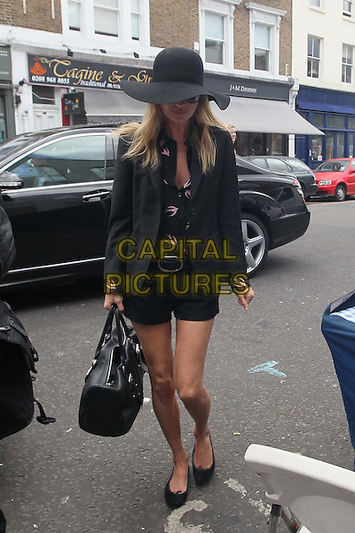 Kate Moss .spotted in Notting Hill, London, England, 29th June 2011.full length large black floppy hat, jacket shorts swallow print blouse.CAP/HIL.©John Hillcoat/Capital Pictures.