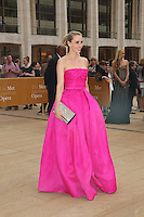 Guests walk the red carpet at the American Ballet Theatre's Opening Night Spring Gala at the Metropolitan Opera House at Lincoln Center in New York City on May 12, 2014