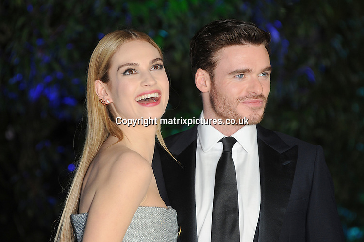 NON EXCLUSIVE PICTURE: PAUL TREADWAY / MATRIXPICTURES.CO.UK<br /> PLEASE CREDIT ALL USES<br /> <br /> WORLD RIGHTS<br /> <br /> English actress Lily James and Scottish actor, Richard Madden attending the UK Premiere of Cinderella at Odeon Leicester Square, in London.<br /> <br /> MARCH 19th 2015<br /> <br /> REF: PTY 15861