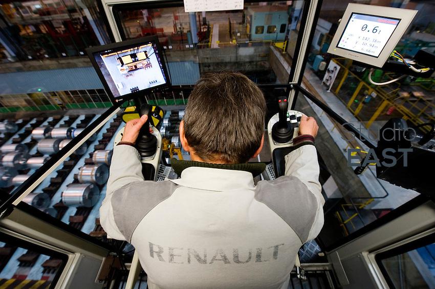 Crane Operator Jean-Rene Rousselin operates a KoneCranes Smarton 34 T M8 Crane to lift a steel coil in Renault's Sandouville workshops, near Le Havre, Normandy region, France, on November 24, 2011. Photo by Lucas Schifres/Pictobank