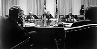 General Creighton W. Abrams, U.S. commander in South Vietnam, discusses the military situation in Vietnam with President Johnson and his advisors October 29 at the White House in Washington.  1968.  White House. (USIA)