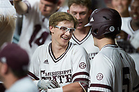 Rowdey Jordan (4) of the Mississippi State Bulldogs shares a laugh with teammate Tanner Allen (5) during the game against the Houston Cougars in game six of the 2018 Shriners Hospitals for Children College Classic at Minute Maid Park on March 3, 2018 in Houston, Texas. The Bulldogs defeated the Cougars 3-2 in 12 innings. (Brian Westerholt/Four Seam Images)