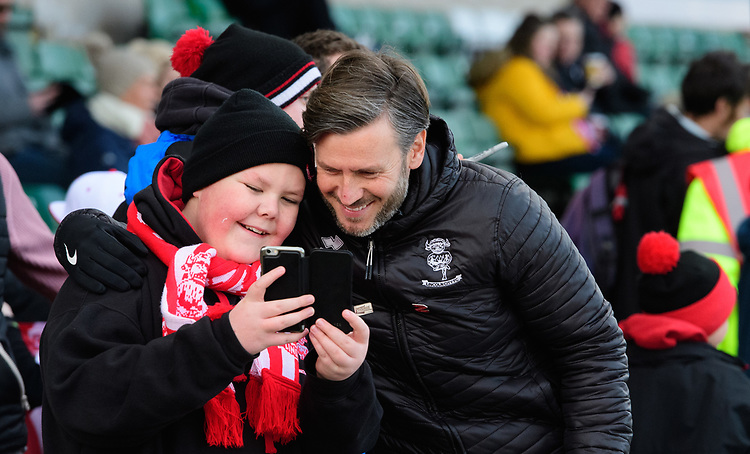 Lincoln City's assistant manager Nicky Cowley poses for a selfie with a fan during the pre-match warm-up<br /> <br /> Photographer Chris Vaughan/CameraSport<br /> <br /> The EFL Sky Bet League Two - Lincoln City v Northampton Town - Saturday 9th February 2019 - Sincil Bank - Lincoln<br /> <br /> World Copyright &copy; 2019 CameraSport. All rights reserved. 43 Linden Ave. Countesthorpe. Leicester. England. LE8 5PG - Tel: +44 (0) 116 277 4147 - admin@camerasport.com - www.camerasport.com