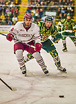 24 November 2013: University of Massachusetts Forward Steven Iacobellis, a Freshman from Pt Coquitlam, British Columbia, is followed closely by University of Vermont Catamount Forward Mike Stenerson, a Freshman from Surrey, British Columbia at Gutterson Fieldhouse in Burlington, Vermont. The Cats shut out the Minutemen 2-0 to sweep the 2-game home-and-away weekend Hockey East Series. Mandatory Credit: Ed Wolfstein Photo *** RAW (NEF) Image File Available ***