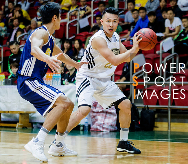 Ling Kwan Lung #22 of Eagle Basketball Team looks to pass the ball against Winling during the Hong Kong Basketball League game between Eagle and Winling at Southorn Stadium on May 4, 2018 in Hong Kong. Photo by Yu Chun Christopher Wong / Power Sport Images