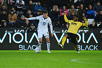 Kristoffer Peterson of Swansea City battles with Jayson Molumby of Millwall during the Sky Bet Championship match between Swansea City and Millwall at the Liberty Stadium in Swansea, Wales, UK. Saturday 23rd November 2019