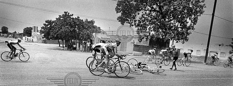 A crash between Dutchman Joost Conijn and the Senegalese cyclist Olivier Keita..The Tour du Senegal, a two-week cycle race held in average temperatures of 40 degrees Celsius, traverses the country with a total distance of 1168km.