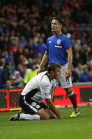 Ian Black stands over the grounded Ryan McGuffie in the Rangers v Queen of the South Quarter Final match in the Ramsdens Cup played at Ibrox Stadium, Glasgow on 18.9.12.