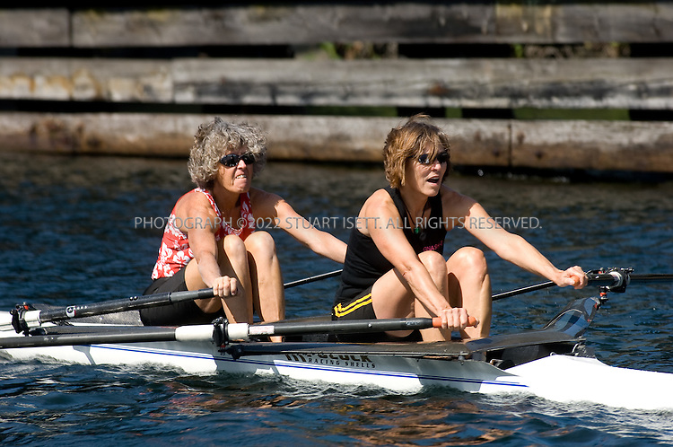 9/6/2007--Seattle, WA, USA..Joan Linse (black top) and Susan Kinne (red patterned top) row on Seattle's Lake Union wearing aqua-socks they are testing...©2007 Stuart Isett. All rights reserved