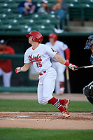 Peoria Chiefs second baseman Andy Young (15) follows through on a swing during a game against the West Michigan Whitecaps on May 8, 2017 at Dozer Park in Peoria, Illinois.  West Michigan defeated Peoria 7-2.  (Mike Janes/Four Seam Images)