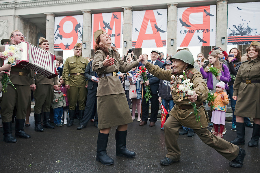 Moscow, Russia, 09/05/2012..An army veteran dancing with a woman in World War Two era Soviet uniform as Russian World War Two veterans and well-wishers gather in Gorky Park during the countrys annual Victory Day celebrations.