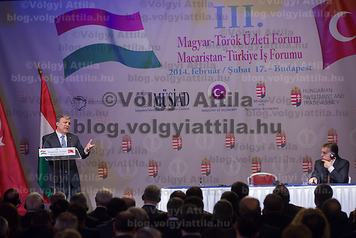 Abdullah Gul (L) president of Turkey and Viktor Orban (R) prime minister of Hungary talk during a business conference in Budapest, Hungary on February 17, 2014. ATTILA VOLGYI