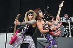 Travis Haley and Russ Parrish of Steel Panther perform during the 2013 Rock On The Range festival at Columbus Crew Stadium in Columbus, Ohio.