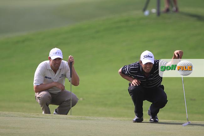 Padaig Harrington and Adam Scott line up their putts on the 7th green during  Day 2 at the Dubai World Championship Golf in Jumeirah, Earth Course, Golf Estates, Dubai  UAE, 20th November 2009 (Photo by Eoin Clarke/GOLFFILE)