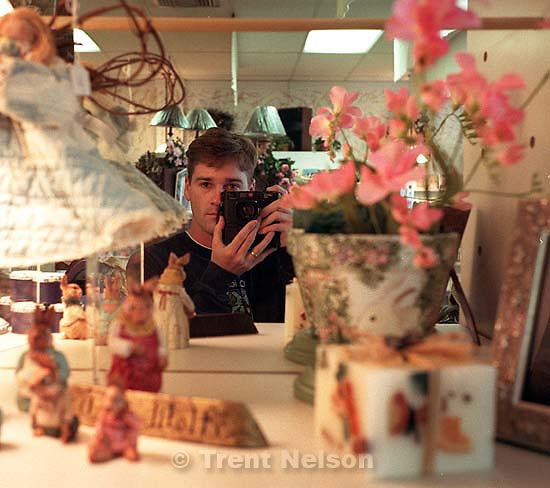 Trent Nelson in mirror with Leica<br />
