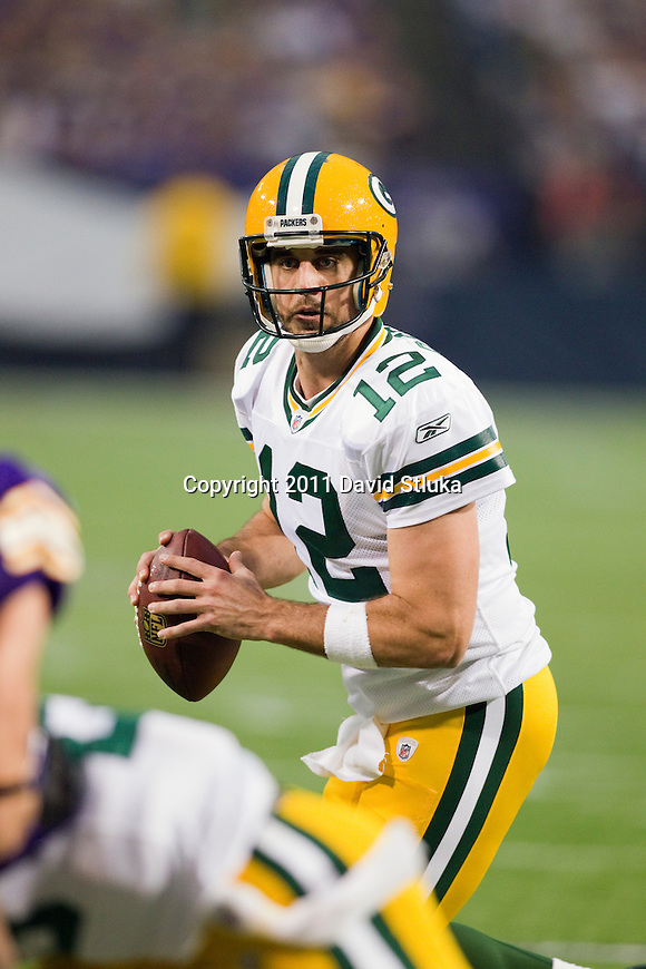 Green Bay Packers quarterback Aaron Rodgers (12) looks for a receiver during a Week 7 NFL football game against the Minnesota Vikings on October 23, 2011 in Minneapolis, Minnesota. The Packers won 33-27. (AP Photo/David Stluka)