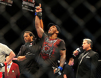 Oct. 29, 2011; Las Vegas, NV, USA; UFC fighter Francis Carmont (right) celebrates as referee Herb Dean announces him the winner of a middleweight bout during UFC 137 at the Mandalay Bay event center. Mandatory Credit: Mark J. Rebilas-
