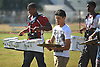 Aaron Dawson of Clarke High School, left, practices with the marching band on the school's football field on Friday, September 18, 2015. The senior excels as both a drummer and a running back on the gridiron.<br /> <br /> James Escher