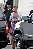 Sasha Obama leaves the North Portico of the White House to attend a Church service April 20, 2014 in Washington, DC. <br /> Credit: Olivier Douliery / Pool via CNP