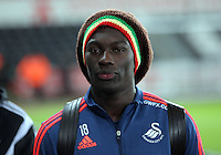 Bafetimbi Gomis of Swansea arrives before the Barclays Premier League match between Swansea City and Watford at the Liberty Stadium, Swansea on January 18 2016