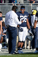 STATE COLLEGE, PA - SEPTEMBER 30:  Penn State RB Saquon Barkley (26) listens to running backs coach and special teams coordinator Charles Huff on the sideline. The Penn State Nittany Lions defeated the Indiana Hoosiers 45-14 on September 2, 2017 at Beaver Stadium in State College, PA. (Photo by Randy Litzinger/Icon Sportswire)
