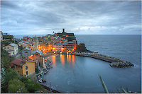 Vernazza is located in the Cinque Terre along the Ligurian Coast of Italy. This picturesque villages is one of the most amazing places I've visited. The seafood and wine are wonderful, and finish off a great meal with Sciachetrà, the local dessert wine.
