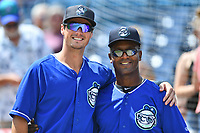 Asheville Tourists designated hitter Tyler Bugner and hitting coach Paco Martin and  before a game against the Rome Braves at McCormick Field on September 3, 2018 in Asheville, North Carolina. The Tourists defeated the Braves 5-4. (Tony Farlow/Four Seam Images)