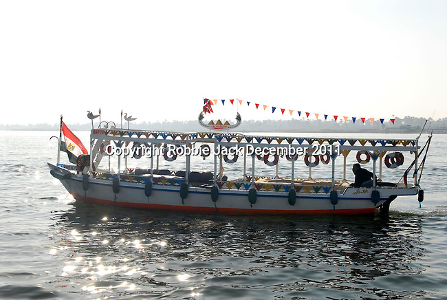 A small ferry boat on the River Nile at Luxor.The town of Luxor occupies the eastern part of a great city of antiquity which the ancient Egytians called Waset and the Greeks named Thebes.