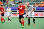 The Hague, Netherlands, June 10: Seunghoon Lee #21 of Korea looks on during the field hockey group match (Men - Group B) between Germany and Korea on June 10, 2014 during the World Cup 2014 at Kyocera Stadium in The Hague, Netherlands. Final score 6-1 (3-0) (Photo by Dirk Markgraf / www.265-images.com) *** Local caption *** Seunghoon Lee #21 of Korea, Thilo Stralkowski #26 of Germany