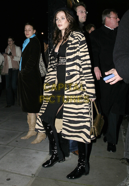 "ANNA FRIEL.Leaving performance of ""Drallion"", Cirque du Soleil, Royal Albert Hall, London, January 6th 2005..full length zebra striped coat black and white stripes animal print knee high black boots dress.Ref: AH.www.capitalpictures.com.sales@capitalpictures.com.©Capital Pictures."