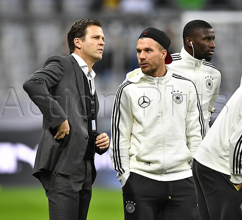 29.03.2016. Munich, Germany. International soccer match between Germany and Italy, at the Allianz Arena.  Manager Oliver Bierhoff (GER) speaks with Lukas Podolski (GER) and Antonio Rudiger (GER)