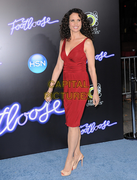 Andie MacDowell .The L.A. Premiere of 'Footloose' held at The Regency Village Theater in Westwood, California, USA..October 3rd, 2011.full length red sleeveless dress beige nude shoes peep toe   .CAP/RKE/DVS.©DVS/RockinExposures/Capital Pictures.
