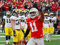 Ohio State Buckeyes defensive back Vonn Bell (11) celebrates a fumble returned for a touchdown by teammate linebacker Darron Lee (43) during the 4th quarter of the NCAA football game against the Michigan Wolverines at Ohio Stadium on Nov. 29, 2014. (Adam Cairns / The Columbus Dispatch)