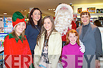 SANTA FUN: Enjoying Santa's visit to the CH Chemist Customer Christmas evening on Friday l-r: Leah Herrick, Catherina Foran, Amanda Nolan, Santa Clause, Catherine and Luda Becyakov.