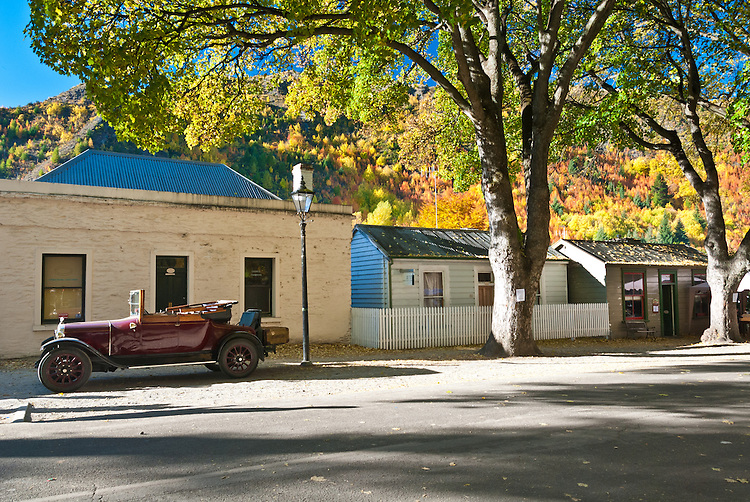 Historic cottages, vintage car,  Arrowtown, Autumn, Central Otago, South Island, New Zealand - stock photo, canvas, fine art print