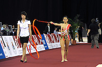 Ines Gomes of Portugal walks to carpet before ribbon routine at 2009 Budapest World Cup on March 7, 2009 at Budapest, Hungary.  Photo by Tom Theobald.