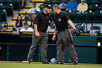 Umpires Clay Park (right) and James Rackley (left) during a game between the Bradenton Marauders and St. Lucie Mets on April 12, 2013 at McKechnie Field in Bradenton, Florida.  St. Lucie defeated Bradenton 6-5 in 12 innings.  (Mike Janes/Four Seam Images)