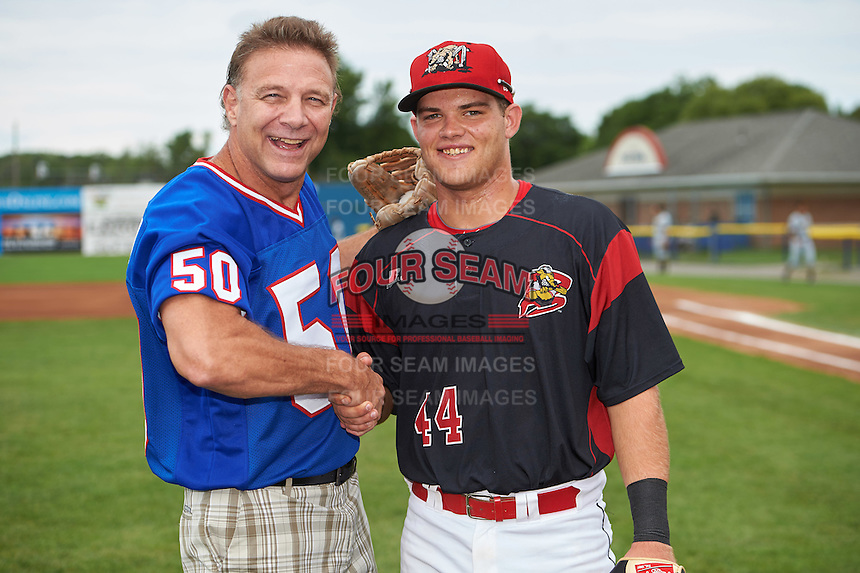 Former Buffalo Bills linebacker Ray Bentley with catcher Jarett Rindfleisch (44) after throwing out a ceremonial first pitch before a Batavia Muckdogs game against the West Virginia Black Bears on August 21, 2016 at Dwyer Stadium in Batavia, New York.  West Virginia defeated Batavia 6-5. (Mike Janes/Four Seam Images)