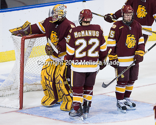 Kenny Reiter (Duluth - 35), Luke McManus (Duluth - 22), Justin Crandall (Duluth - 25) - The Boston College Eagles defeated the University of Minnesota Duluth Bulldogs 4-0 to win the NCAA Northeast Regional on Sunday, March 25, 2012, at the DCU Center in Worcester, Massachusetts.