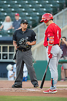 Home plate umpire Luis Hernandez looks to the dugout as Springfield Cardinals infielder Evan Mendoza (4) steps to the plate on May 16, 2019, at Arvest Ballpark in Springdale, Arkansas. (Jason Ivester/Four Seam Images)
