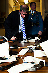 New Jersey, United States. 15th February 2013 -- NJ's Attorney General Jeffrey S. Chiesa checks weapons on a table after being acquired during the Gun Buyback program in New Jersey. Photo by Eduardo Munoz Alvarez / VIEWpress.
