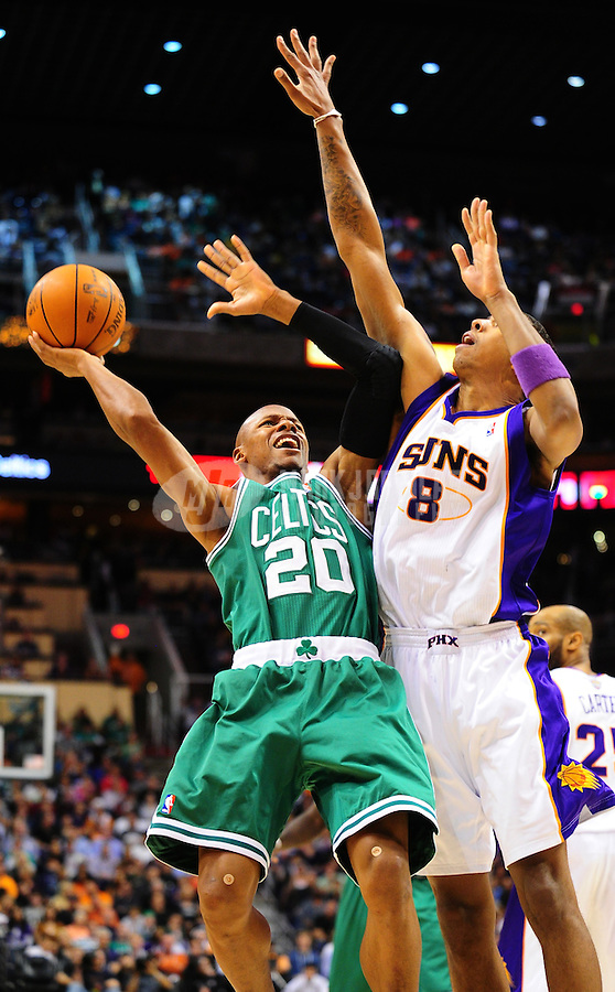 Jan. 28, 2011; Phoenix, AZ, USA; Boston Celtics guard (20) Ray Allen drives to the basket against Phoenix Suns center (8) Channing Frye in the second quarter at the US Airways Center. Mandatory Credit: Mark J. Rebilas-
