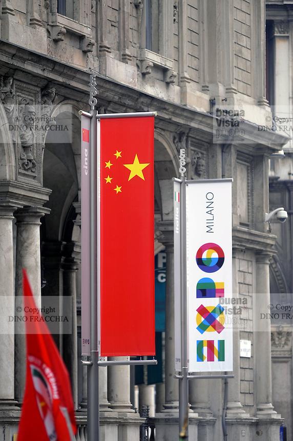 - Milan, flags for Expo 2015 near Duomo square<br /> <br /> - Milano, bandiere per l' Expo 2015 nei pressi di piazza Duomo