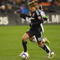 Chris Rolfe dribbles away from LA's defender. DC United defeated the LA Galaxy 1-0 with a stoppage time goal from Chris Pontius at RFK Stadium in Washington DC.