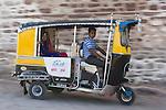 Motorized rickshaw in front of Mehrangarh Fort, Jodphur, Rajasthan, India